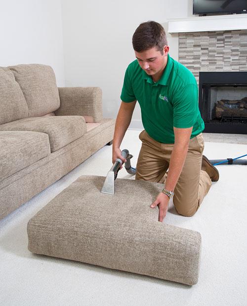 A Chem-Dry of Rialto technician cleaning a couch for a customer